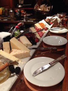 Gourmet cheese selections at Coq d'Or